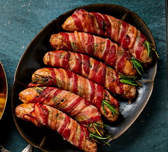 A plate with six jumbo pigs in blankets