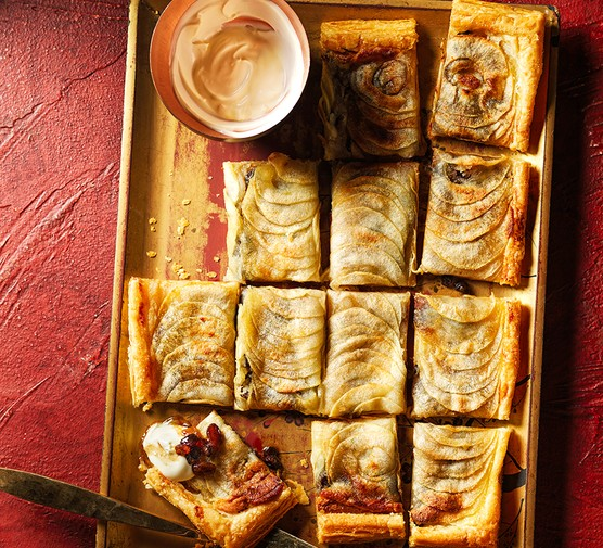 Slices of mincemeat, marzipan & apple tarte fine on a golden tray
