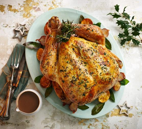 Next level roast turkey served on an oval dish with gravy alongside