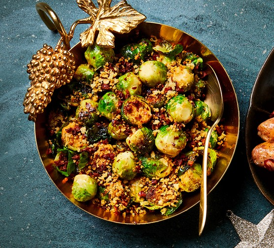 A frying pan serving pan-fried sprouts and crunchy chorizo crumbs