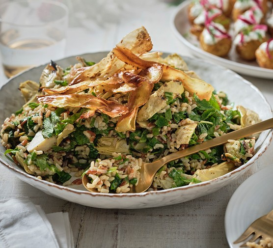 Parsnip, spinach, artichoke and wild rice salad served in a large dish