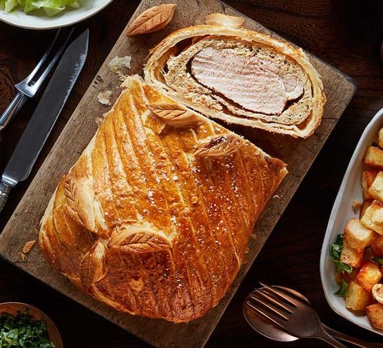 Pork & chestnut wellington on a serving platter
