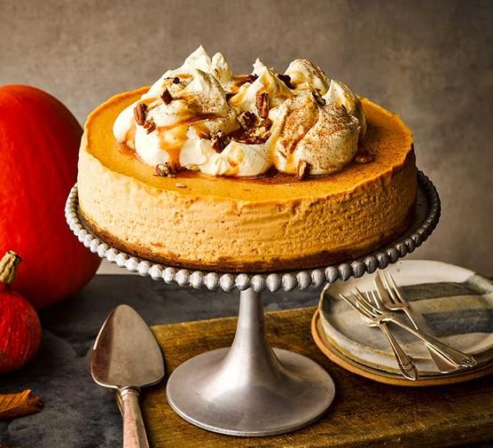 Pumpkin cheesecake on a cake stand