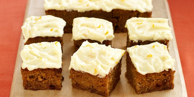 Pumpkin cake with frosting, cut into squares