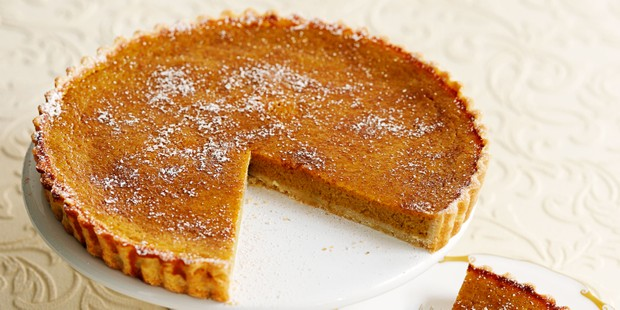 Pumpkin pie with slice taken out