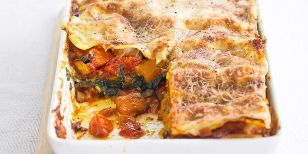 Roast pumpkin and spinach lasagne in a baking dish