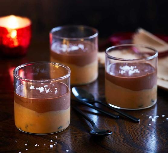 Rum and raisin millionaire's chocolate pots served in three small dessert glasses