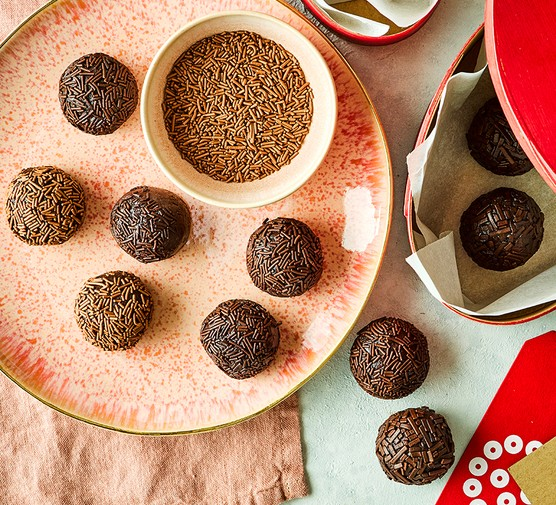 A selection of rum truffles on a plate