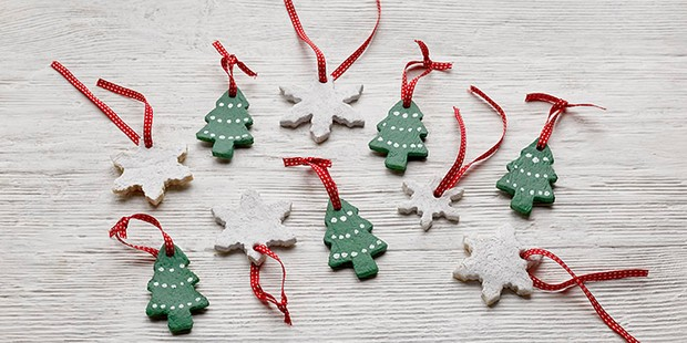 Salt dough Christmas tree and star decorations on red ribbons