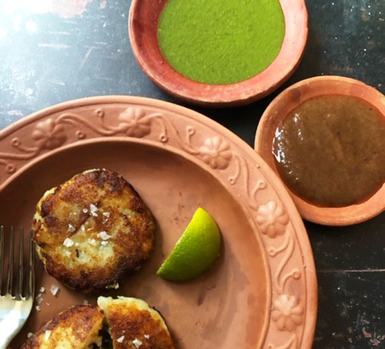 Date and tamarind sauce and coriander relish served with Aloo tikki
