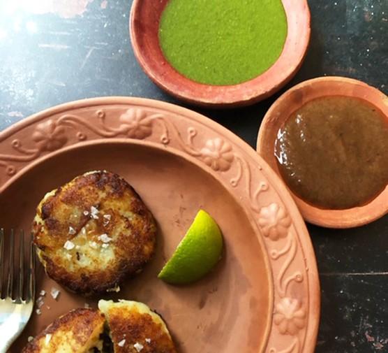 Date and tamarind sauce and coriander relish served with Aloo tikki