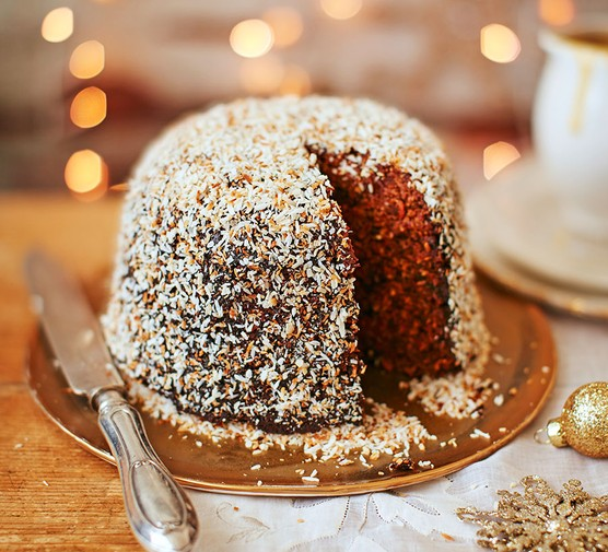 Spiced carrot, coconut & date pudding on a cake stand