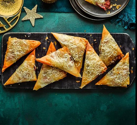 Sticky shallot, fig & almond filo parcels served on a decorative platter