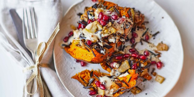 A plate of pumpkin with pomegranates, wild rice and sauce