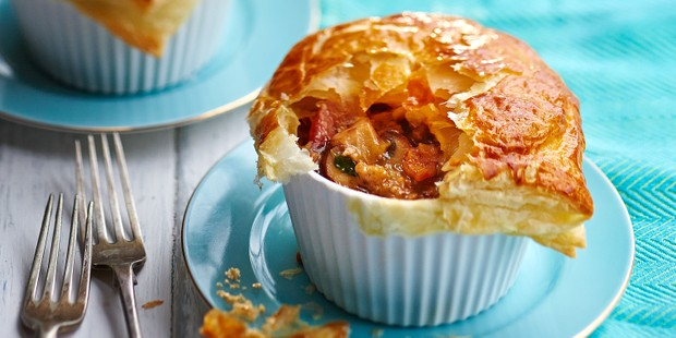 Small turkey and mushroom pot pie in ramekin with puff pastry topping