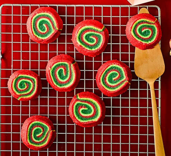 Vegan Christmas pinwheel biscuits on a wire tray