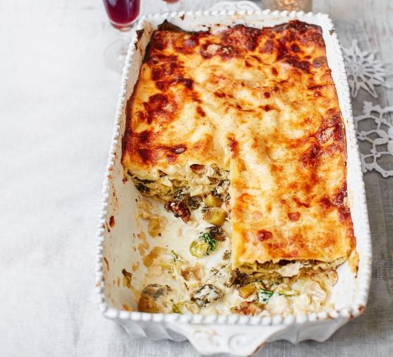 Winter greens, walnut & sage lasagne served in a baking dish