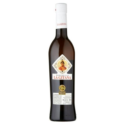 A bottle of manzanilla sherry against a white background