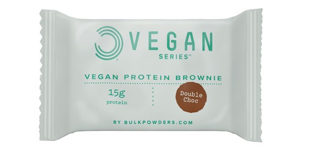 A vegan protein brownie on a white background
