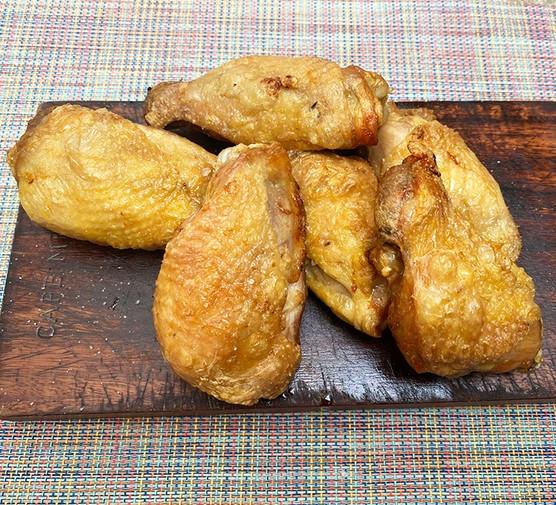 Air fried chicken on a wooden platter