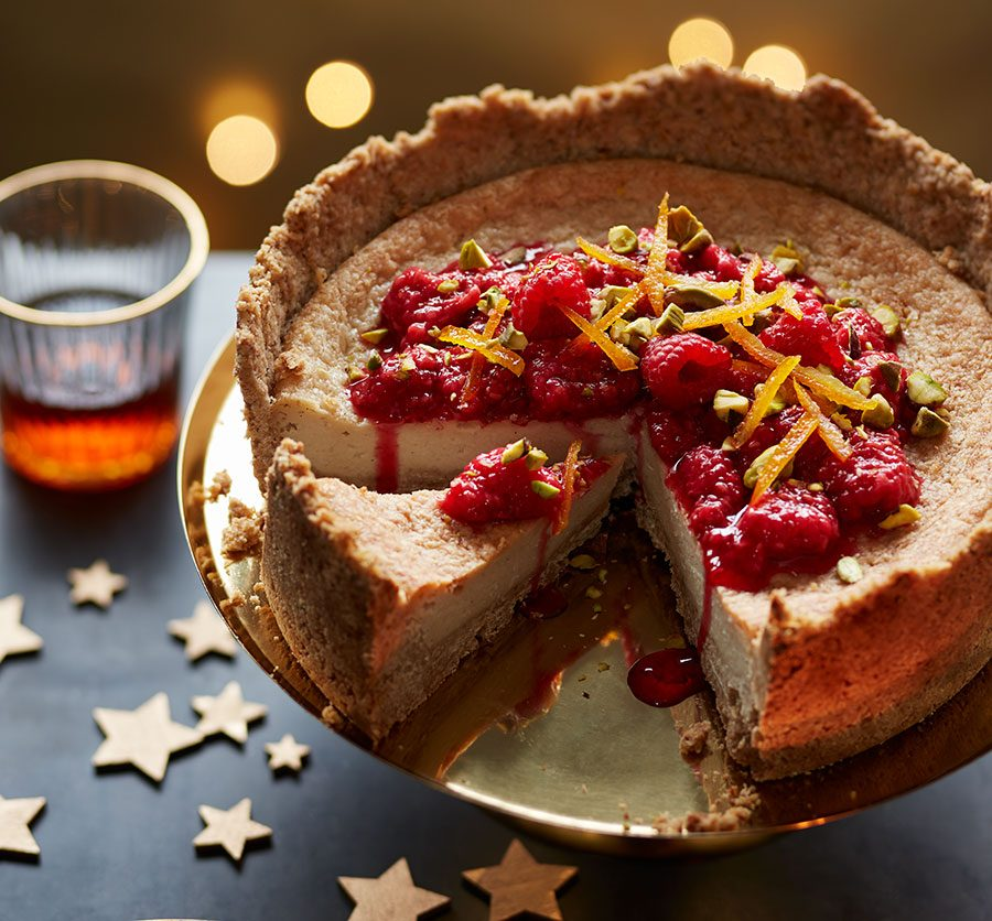 Baked vegan cheesecake with raspberries & clementine