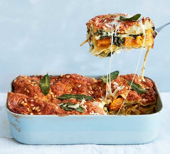 Caramelised squash and spinach lasagne in a baking dish