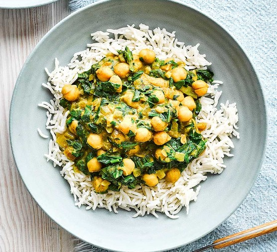 Chickpea, spinach and almond butter bowl served with rice