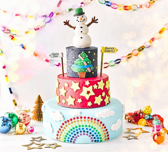 Jessica's magical Christmas cake with party items surrounding it