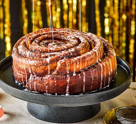 One giant cinnabun on a cake stand