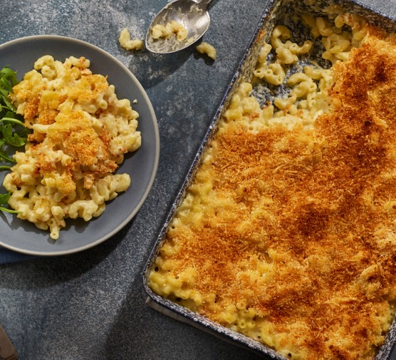 Macaroni cheese on plate and in dish