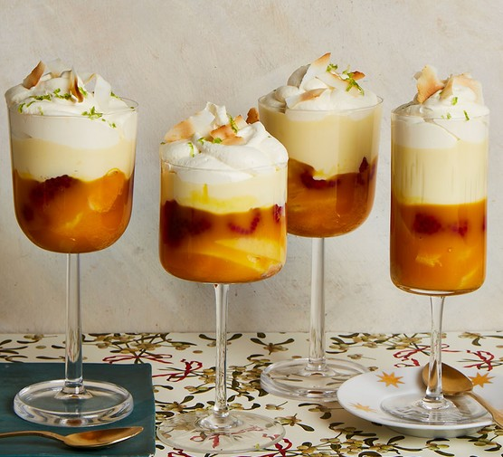 Four mango & coconut trifles in dessert glasses