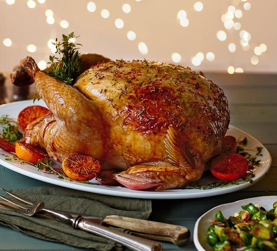 Marmalade-glazed roast turkey & gravy on an oval serving dish