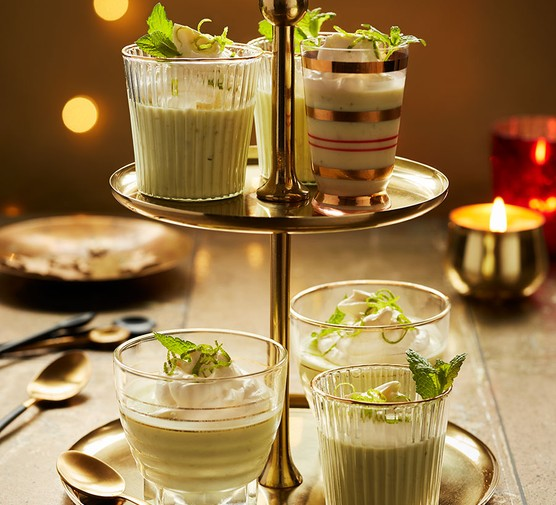 Four mojito possets on a cake stand