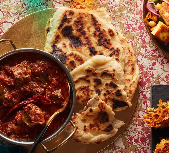 Quick and puffy flatbreads served with curry