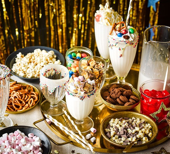 Vanilla milkshake bar with toppings surrounding