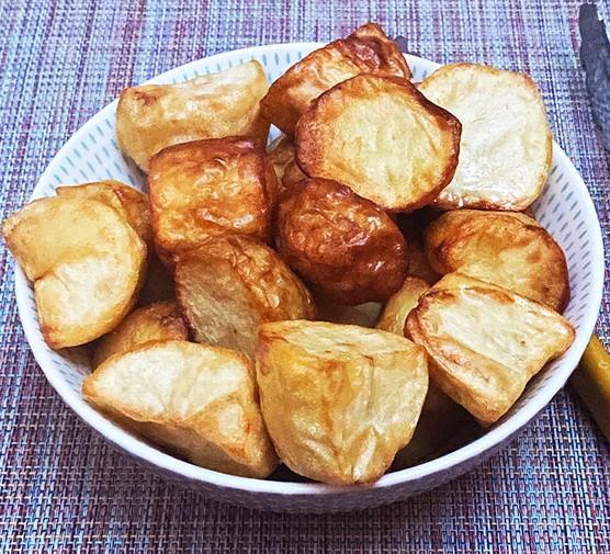 Air fried roast potatoes in a bowl