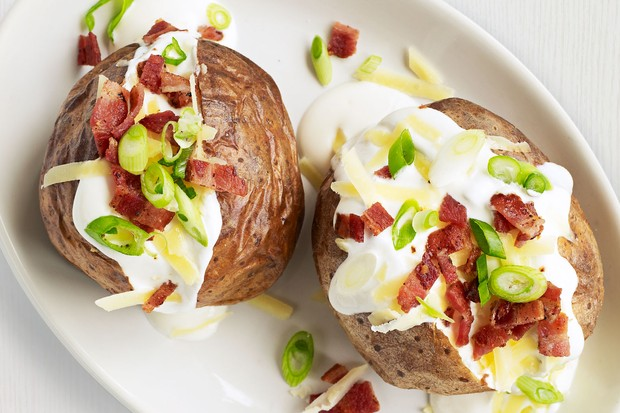 Jacket potatoes with soured cream, cheese and bacon