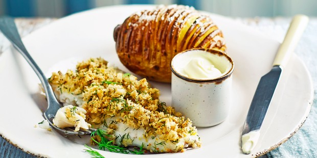 Cod with hasselback potato on plate