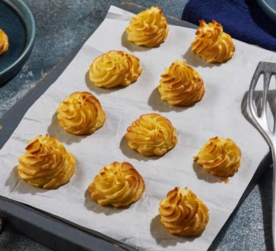 Duchess potatoes on tray