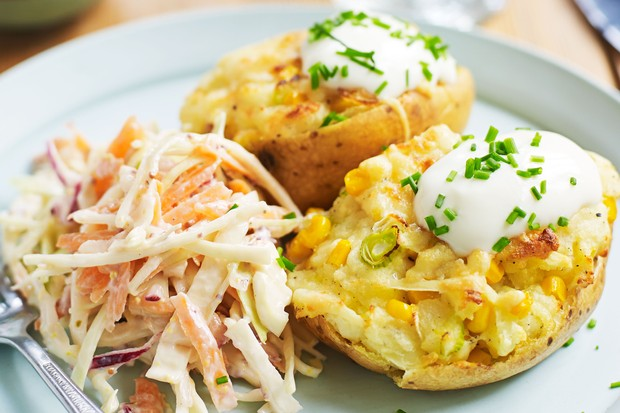 Baked potatoes with slaw & sour cream