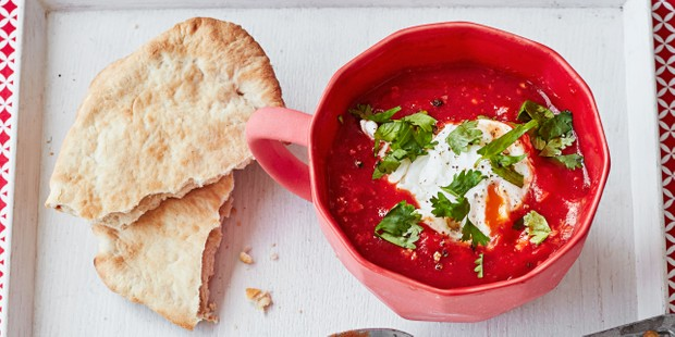 Baked egg in mug with pitta bread