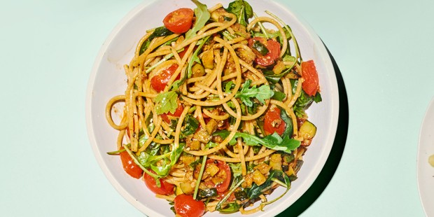 Spaghetti on plate with tomatoes