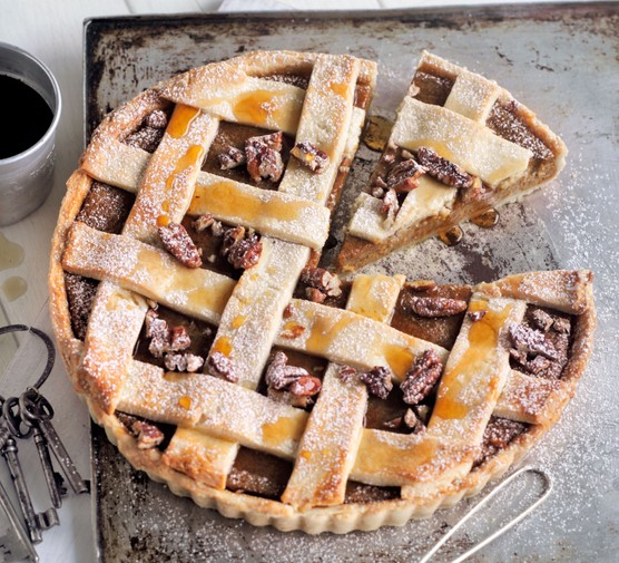 Butternut, pecan and maple lattice pie with a slice cut out