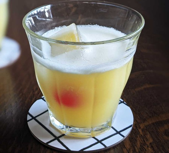 Alcohol-free amaretto sour served in a small tumbler glass