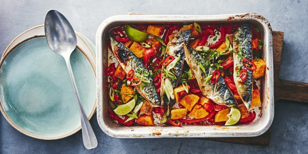 A roasting dish of mackerel, tomatoes and sweet potato chunks