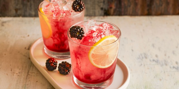Bramble cocktails in glasses with blackberries