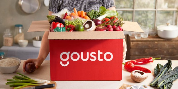 A Gousto recipe box filled with fresh ingredients
