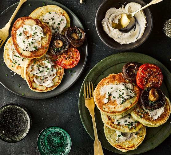 Vegan pancakes on plates with veg