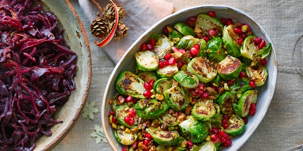 Sprouts with pomegranate seeds in bowl