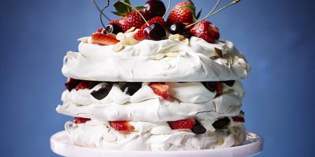 Amaretto meringue cake with strawberries & cherries